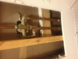 Replacing the corroded faucet valve from the back side.